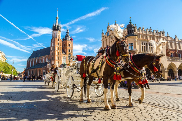 Horse carriages at main square in Krakow in a summer day, Poland ©S-F / Shutterstock