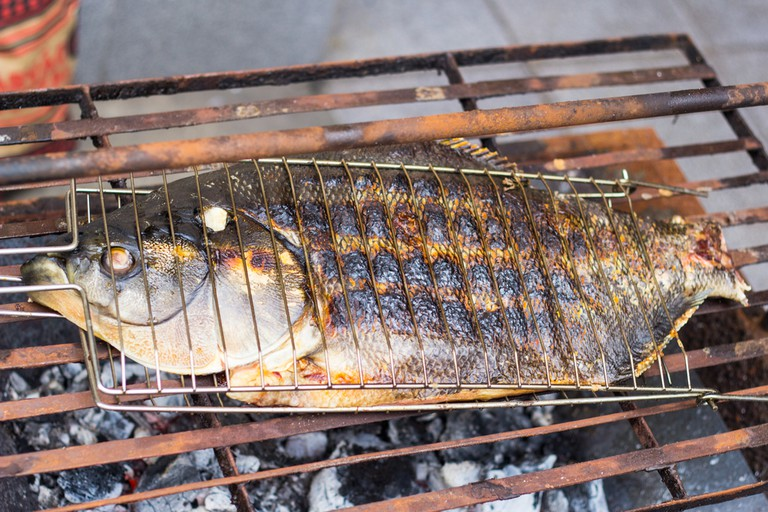 Grilled tambaqui fish on the grill