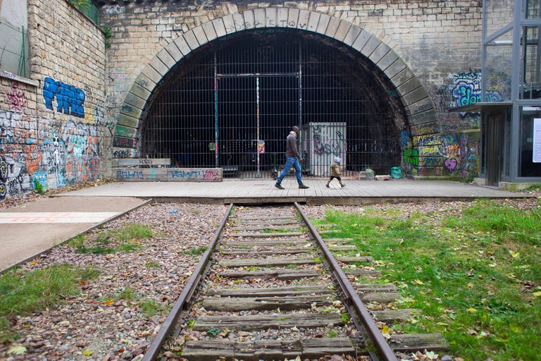 A young child and their father explore La Petite Ceinture