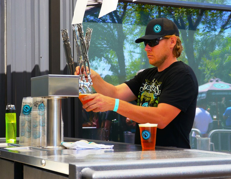 Barman pulling a pint at Ninkasi Brewery