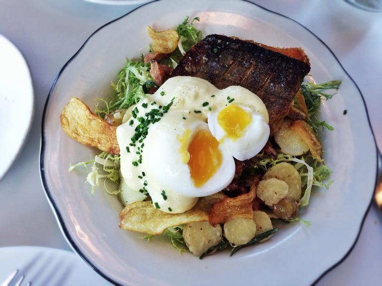 Salad Lyonnaise with sea bass