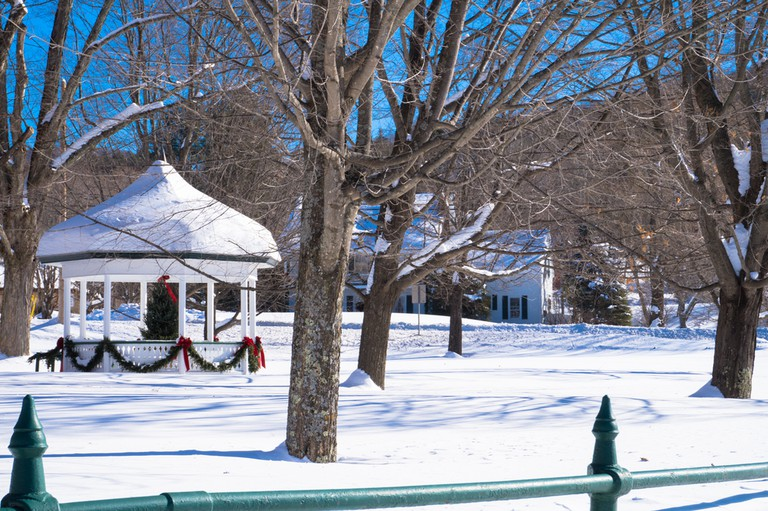 Classic holiday winter scene in a Vermont village with the snow covered Gazebo decorated for Christmas