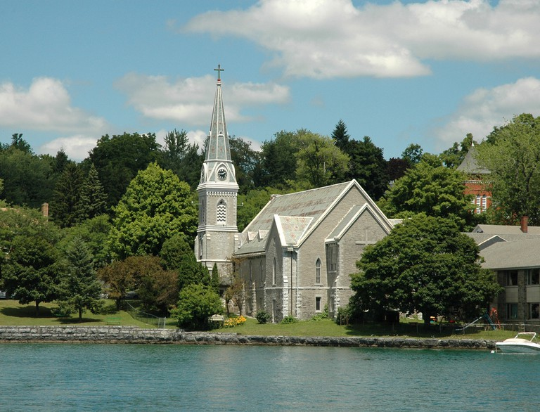 Lake front Church with Steeple and clock tower