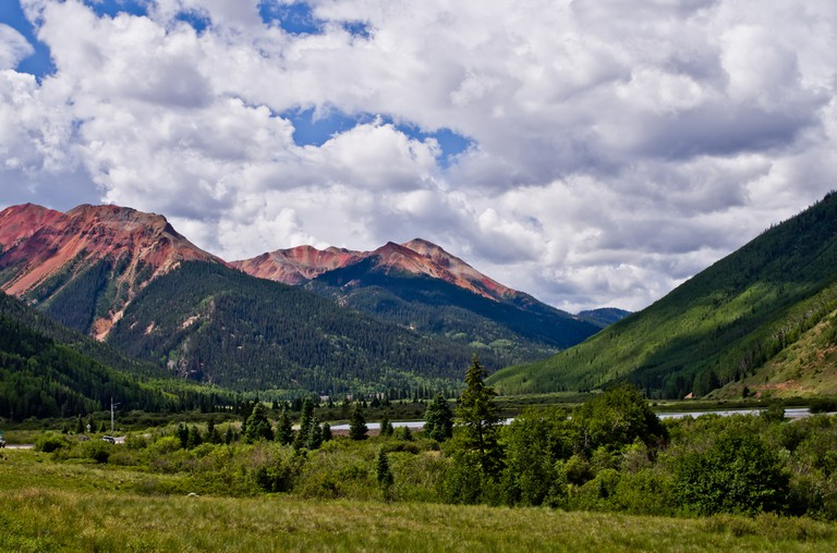 Heavy iron ore deposits turn to iron oxide - rust - which gives the mountains their red color