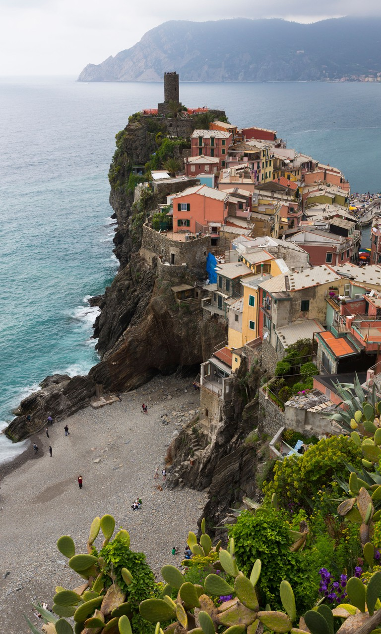 Colorful buildings and beach of Vernazza in Cinque Terre, Italy