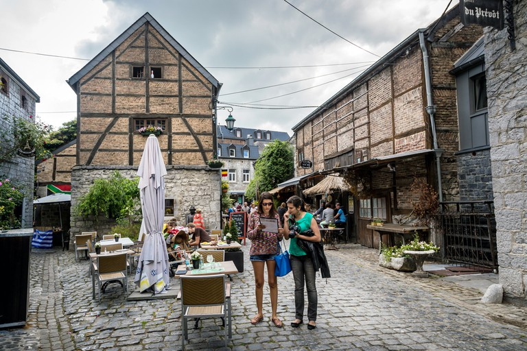 Tourists and locals enjoys the old village of Durbuy in a cloudy hot day. Belgium ©LMspencer / Shutterstock