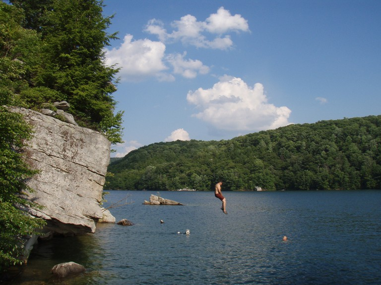 A person plunging into Summesrville Lake, West Virginia