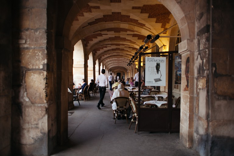 There are a number of restaurants on the Place des Vosges