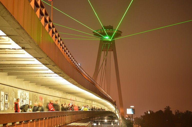 The green laser beam from the UFO Tower is a highlight of September's Festival of Lights!