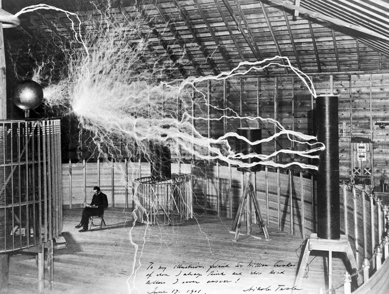 Nikola Tesla, with his equipment