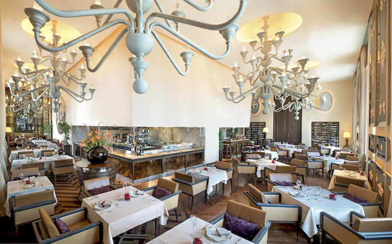 Relax under striking chandeliers as you dine in style at the St Regis' Italian restaurant