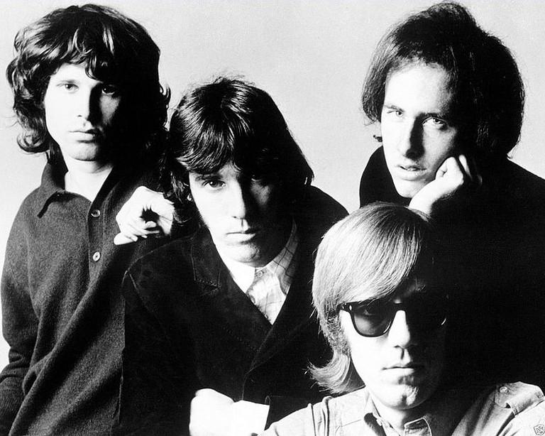 The Doors. From left-Jim Morrison, John Densmore, Robbie Krieger and seated, Ray Manzarek