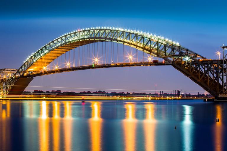 Bayonne Bridge at dusk. The Bayonne Bridge, is the 5th longest steel arch bridge in the world