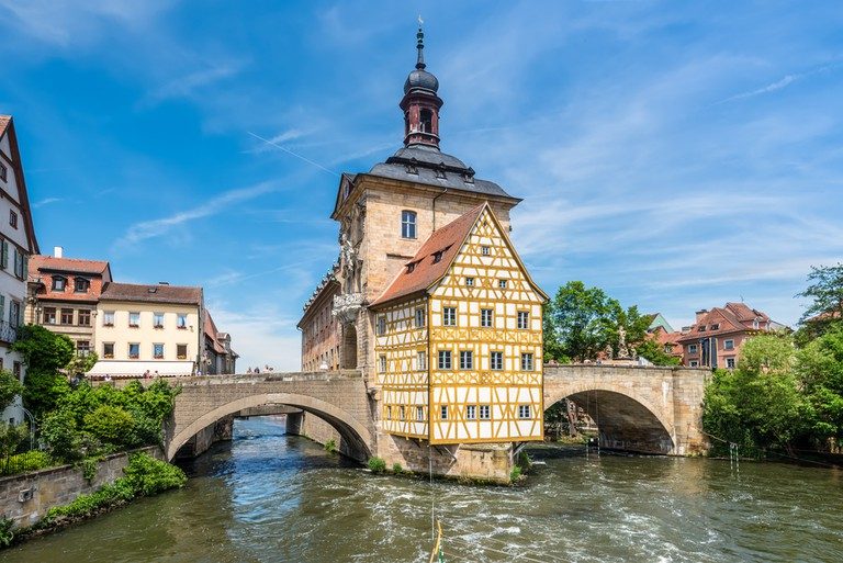 Historical city hall of Bamberg on the bridge across the river Regnitz, along the Castle Road