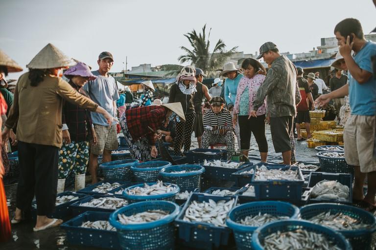 Fishermen in the morning at the beach in Mui Ne
