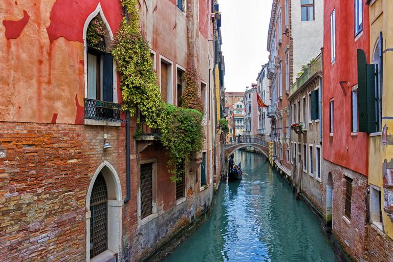 Venice canal with gondola, Italy