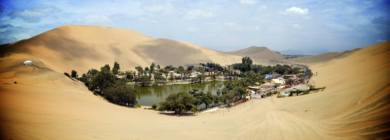 The Huacachina Oasis, in the desert sand dunes near the city of Ica, Peru