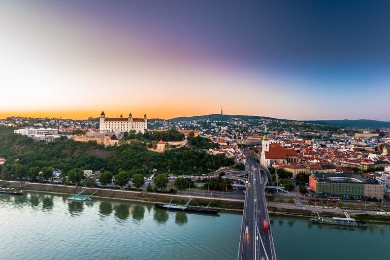 Bratislava city center with Cathedral, historical buildings, and traffic. Beautiful travel picture of Slovakia
