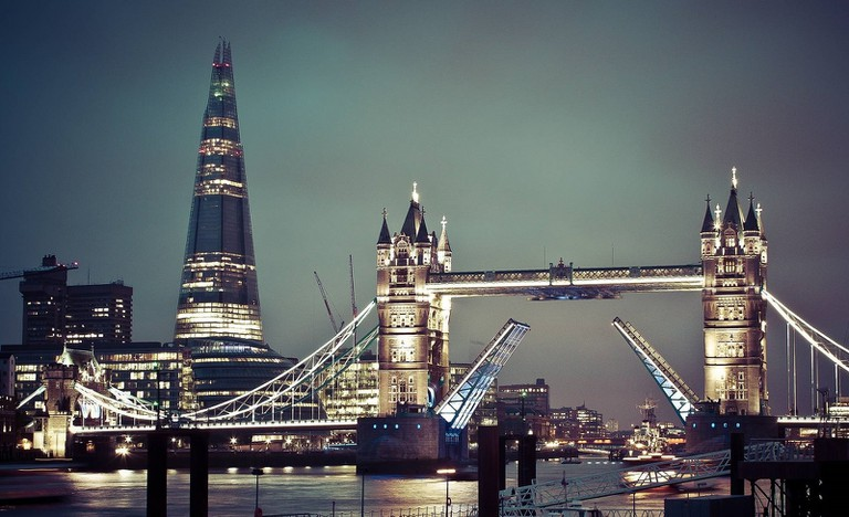 Tower Bridge at night, with a view of The Shard behind it