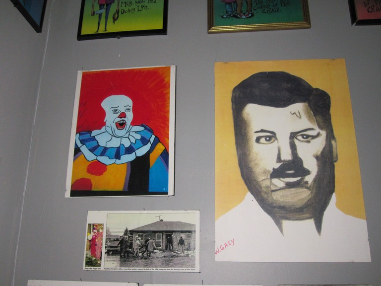 Two examples of Gacy paintings