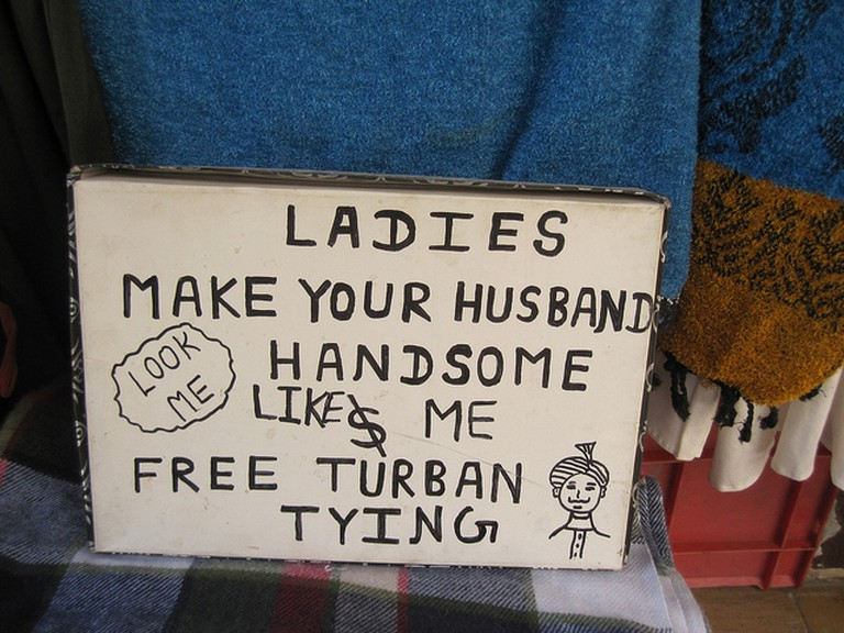 A sign advertises 'free turban-tying'