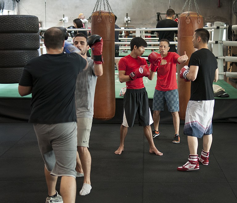 Michele Aboro, teaching boxing to students of the Aboro Academy
