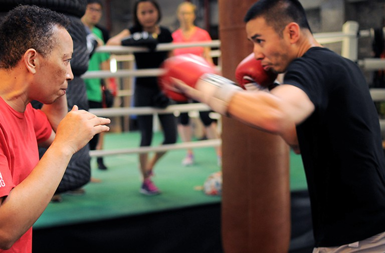 Michele Aboro, teaching boxing to student of the Aboro Academy