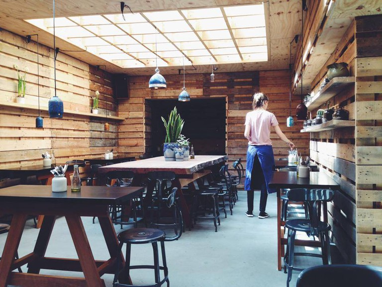 The friendly wooden interior of Henri & Agnes
