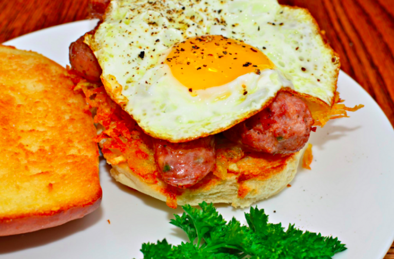 Fried Egg, Sliced Sausage, and Hash Browns on a Grilled Bun