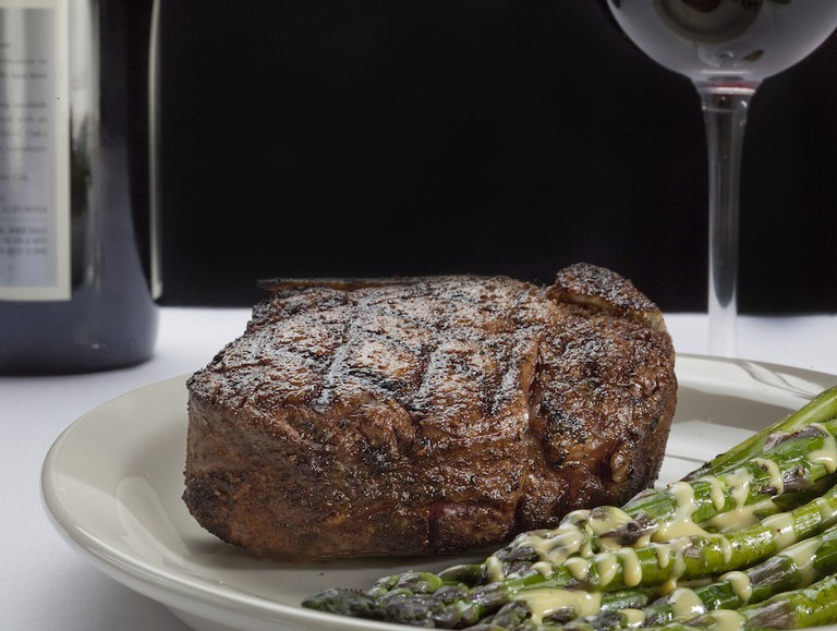 Steak and wine | Courtesy of St. Elmo Steak House