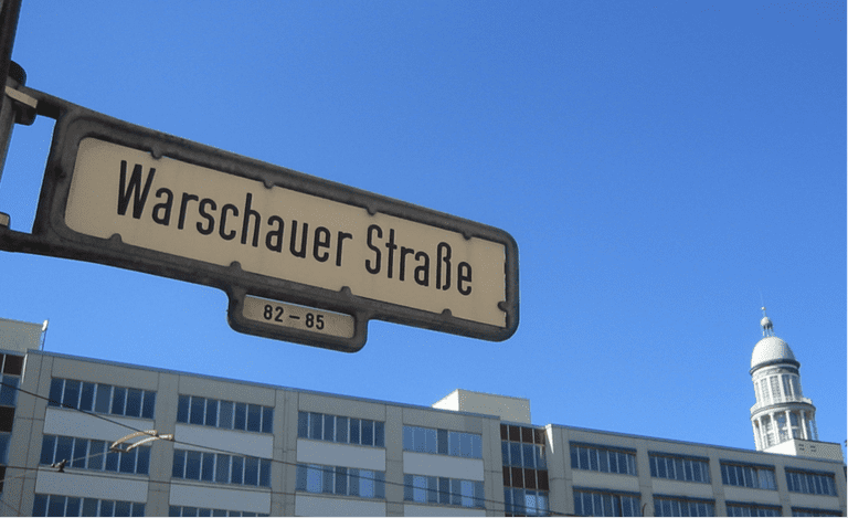 Street sign of Warschauer Straße in Berlin