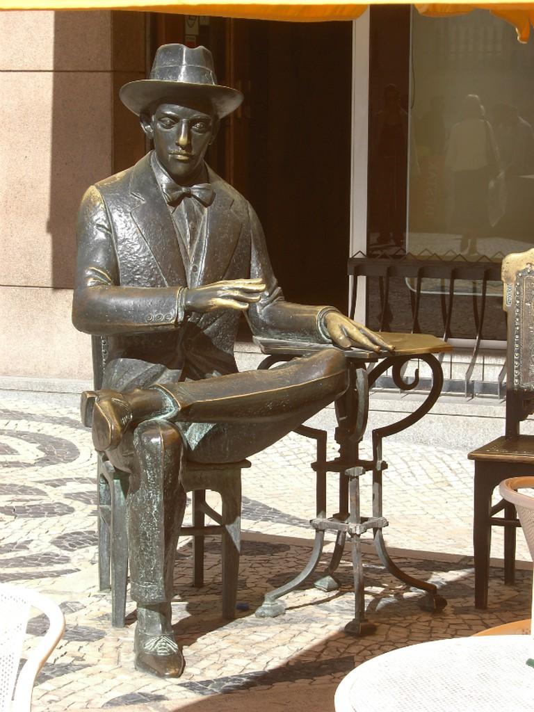 "Monument to Fernando Pessoa in front of cafe ""A Brasileira"", in Lisboa"