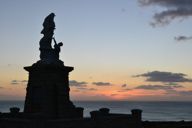 Statue of Notre Dame de Naufrages in the sunset at Pointe du Raz, Brittany, France |© Hristos Fleturis