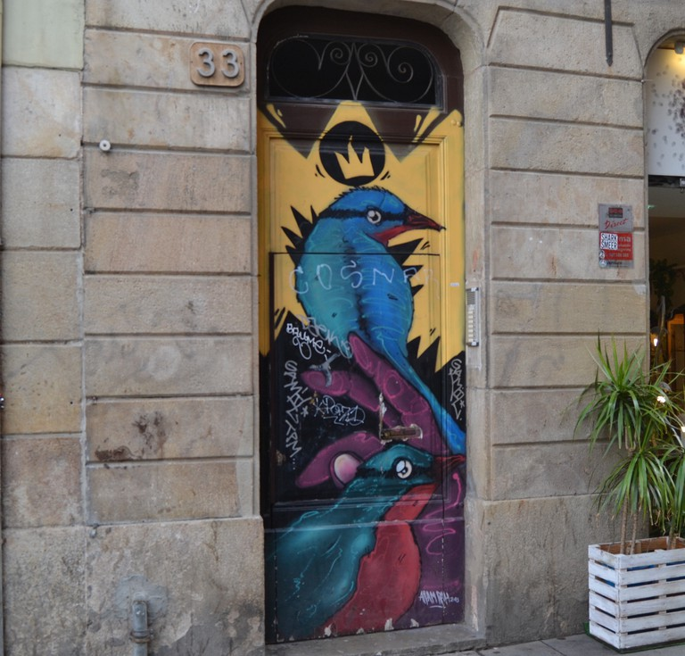 Painted door in the Raval| Photo by Alison Moss