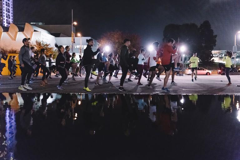 Nike Run Club participants warming up