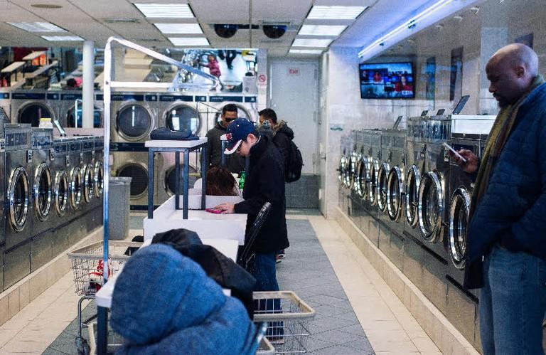 Residents wait at the laundry mat | © Smart Scott Photography