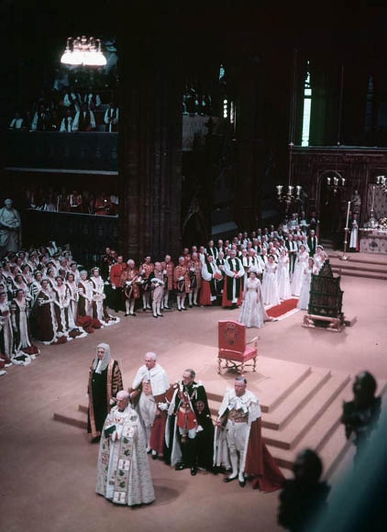 Queen Elizabeth II progresses past the Coronation Chair