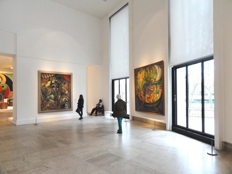 Located to the left, L'Oiseau Bleu by Jean Metzinger, 1912-1913 as seen inside Le Musée d'Art Moderne de la Ville de Paris| © WikiCommons