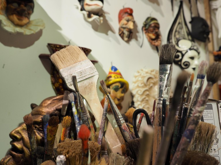 Brushes and masks in a Venetian atelier | Courtesy of Ester Bonadonna
