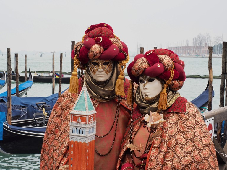 Two masked costumes in St. Mark's square | Courtesy of Ester Bonadonna