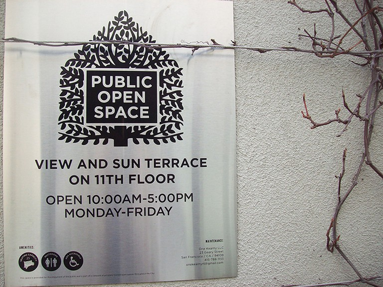 """""""Public Open Space"""" signs, like the one at One Kearny Street, are posted at the entrance of hidden terraces throughout downtown San Francisco that are freely available for public use. © Sylvie Sturm"""