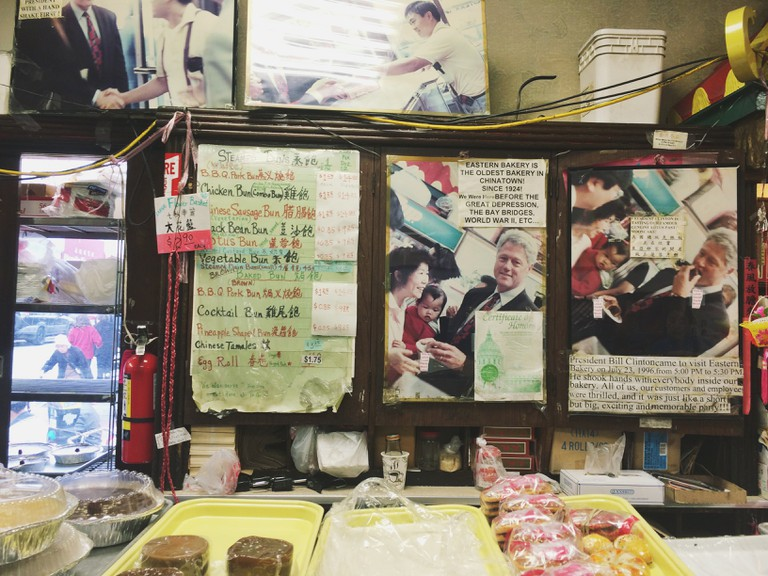 The board hanging inside Eastern Bakery that celebrates the visit of former President Bill Clinton | © Yoojin Shin, All Rights Reserved