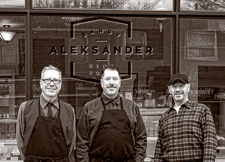 Sandy Aleksander (left to right) owners Bill Hubacheck and Max Ryan, and cheese expert Doug Chiasson   Courtesy of Sandy Aleksander Fine Food