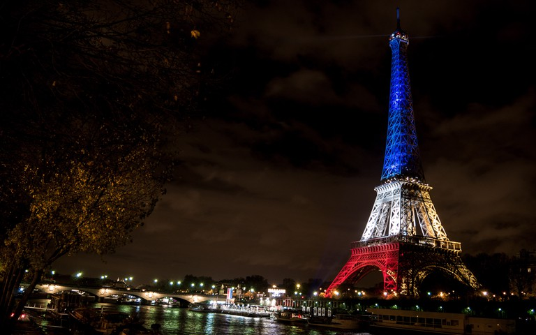 The Eiffel Tower lit in blue, white, and red in honor of the victims of the November attacks| ©Yann Caradec/Flickr