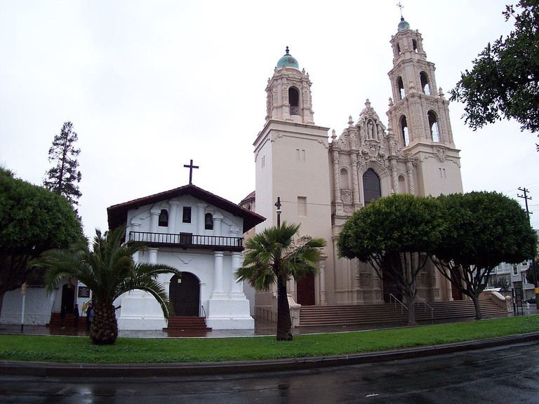 Exterior of Mission, the white building on the left is the surviving adobe chapel