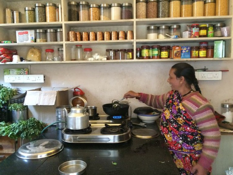 Bimla di happily cooking in the kitchen