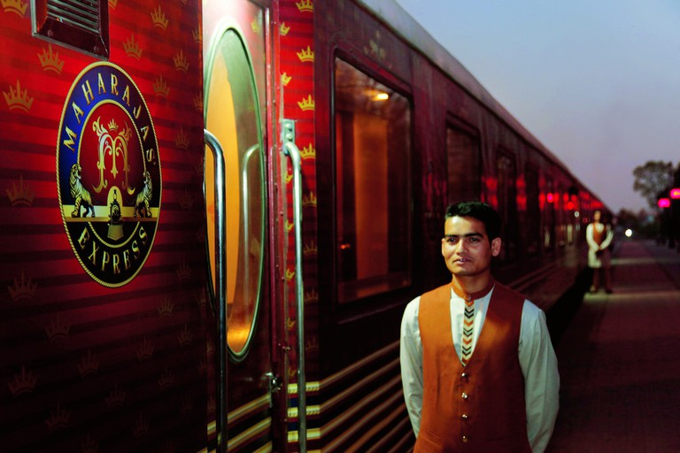 Stewards Stand to Welcome Aboard Maharajah Express | © Simon Pielow/Flickr
