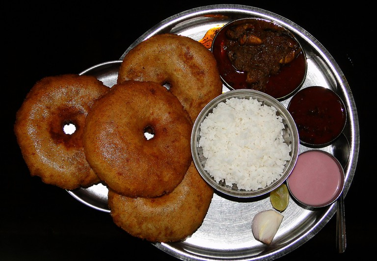 Typical Malwani meal with rice, crab curry, wade and solkadi