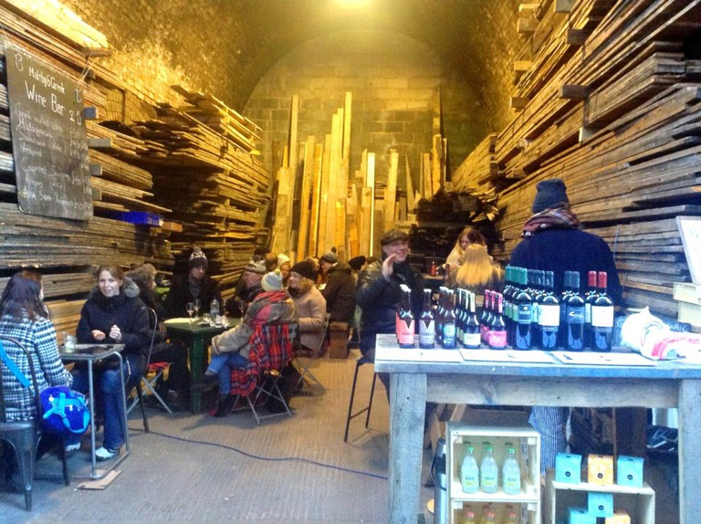 Maltby & Greek setup in the lumber storage arch at Maltby Street Market | Courtesy of Maltby & Greek