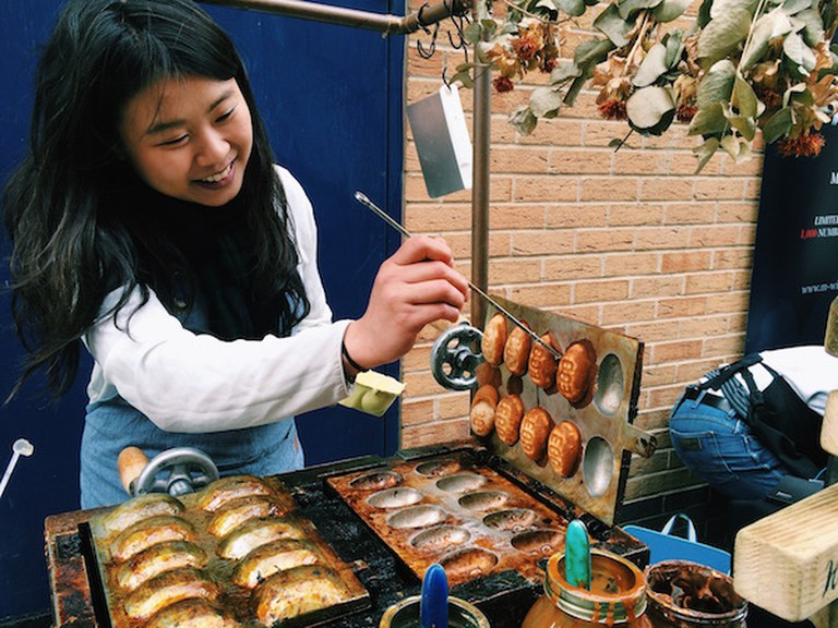 Dhan Waffle owner Irene serving up Taiwanese dhan at Maltby Street Market | Courtesy of Ann Winners